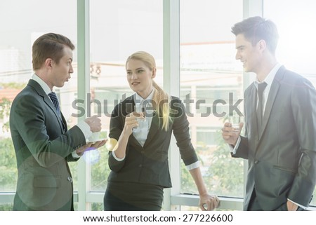 business partners use tablet discussing documents and ideas at meeting - stock photo