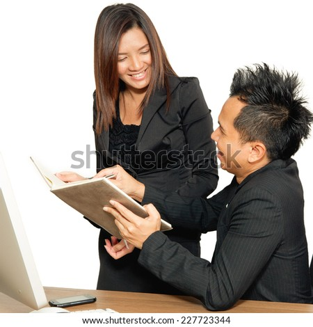 Business partners working at the office on a computer happy coworkers working together, discussing work - stock photo