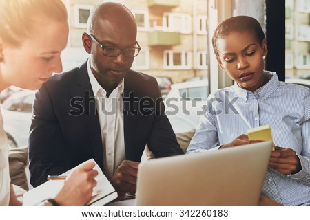Business partners working, multi ethnic group of people, small office