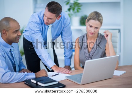 Business partners working on laptop in the office - stock photo