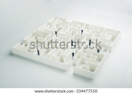 Business partnership. Businessmen navigating through a maze - stock photo