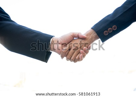 Business partnership meeting concept. Image business man handshake. Successful businessmen handshaking after good deal. Horizontal, blurred background