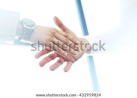 Business partnership meeting concept. Image businessmans handshake.Blurred,sunlights