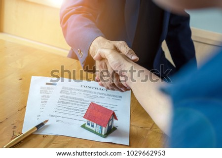 Business partnership meeting concept. Image businessmans handshake. Successful businessmen handshaking after good deal. Bank manager and real estate concept.