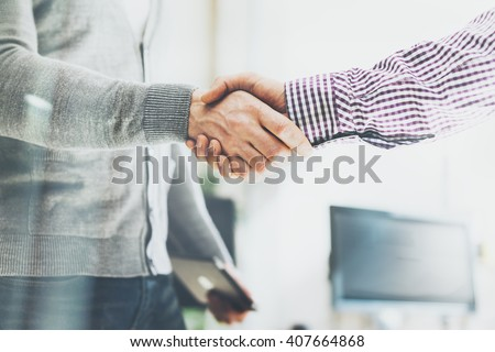 Business partnership meeting. Photo businessmans handshake. Successful businessmen handshaking after good deal. Horizontal, blurred background - stock photo