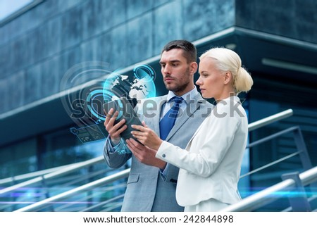 business, partnership, technology and people concept - businessman and businesswoman working with tablet pc computer and globe hologram on city street - stock photo