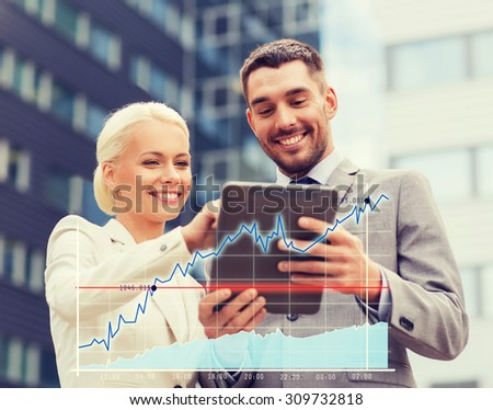 business, partnership, technology and people concept - smiling businessman and businesswoman with tablet pc computer over office building background - stock photo