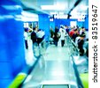 Business passenger at subway station at intentional motion blurred - stock photo
