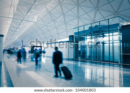 business passenger in the airport, blue tune, shot in asia