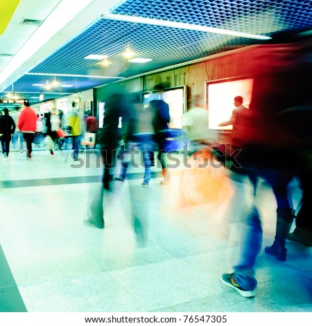 Business passenger walk at subway station at intentional motion blurred - stock photo