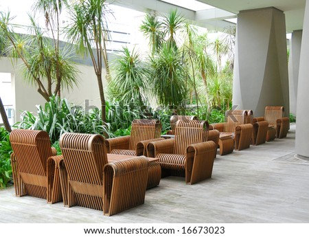 business patio with curved wooden table and chairs - stock photo
