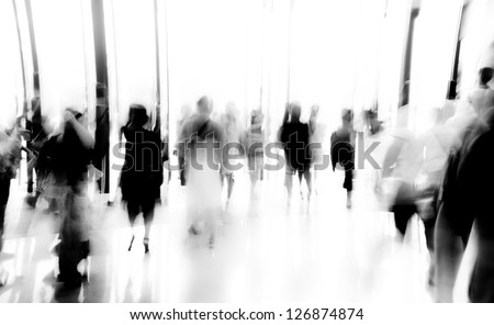 business people activity standing and walking in the lobby motion blurred black and white - stock photo