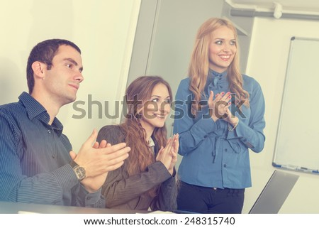 Business people after a successful presentation applauding - stock photo