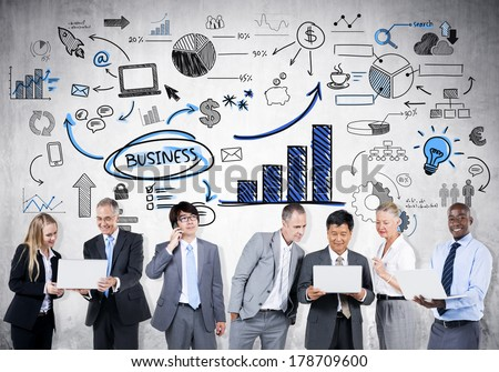 Business People Analysing Financial Trends - stock photo