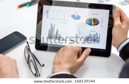 Business people analyzing financial charts and documents in a meeting for the success of company - stock photo