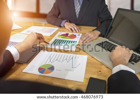 Business people analyzing investment charts in meeting room, Accounting concept, soft focus, vintage tone
