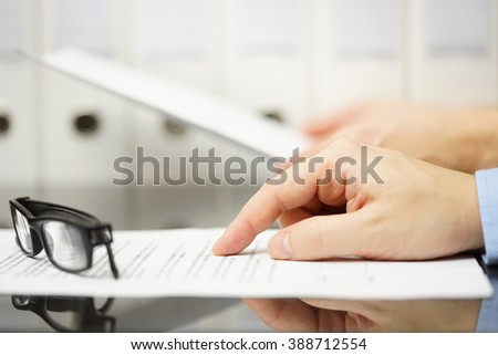 business people analyzing legal or financial document - stock photo