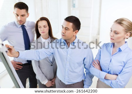 business, people and conference concept - business team meeting on presentation in office - stock photo