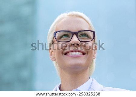 business, people and education concept - young smiling businesswoman over office building - stock photo