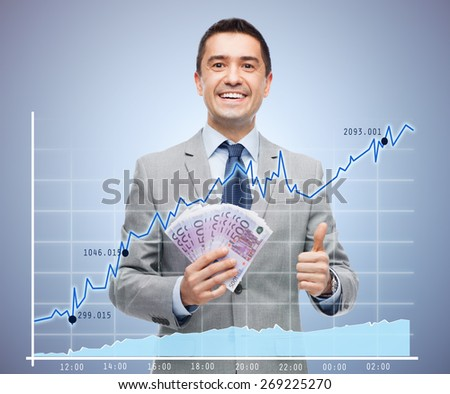 business, people and finances concept - smiling businessman with european money showing thumbs up over growing chart and violet background - stock photo