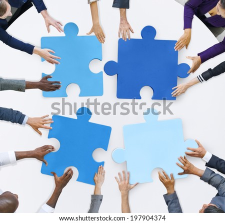 Business People and Jigsaw Puzzle Pieces  - stock photo