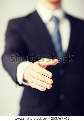 business people and office concept - businessman with open hand ready for handshake - stock photo