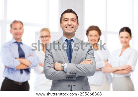 business, people and office concept - happy smiling business team over office room background - stock photo