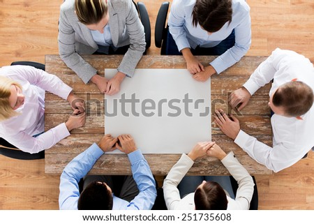 business, people and team work concept - close up of creative team sitting at table in office - stock photo