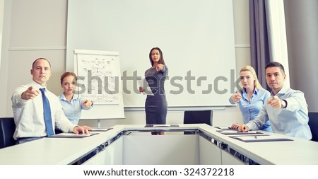 business, people and teamwork concept - group of businesspeople meeting and pointing finger at you in office - stock photo