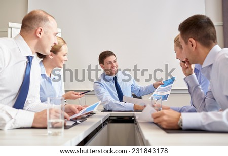 business, people and teamwork concept - group of smiling businesspeople meeting in office - stock photo