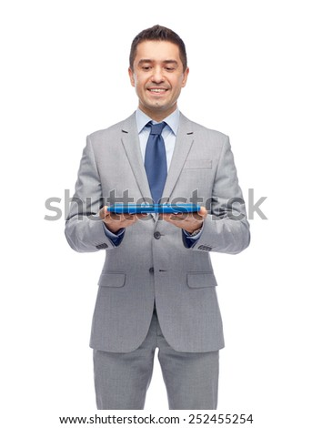 business, people and technology concept - happy smiling businessman in suit holding tablet pc computer - stock photo