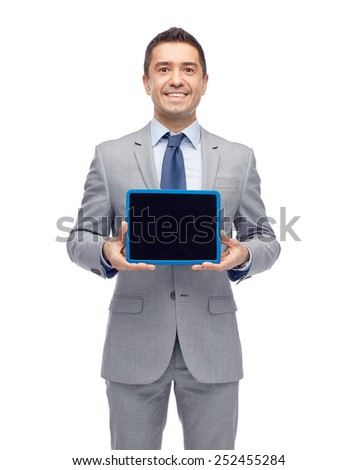 business, people and technology concept - happy smiling businessman in suit showing tablet pc computer black blank screen - stock photo