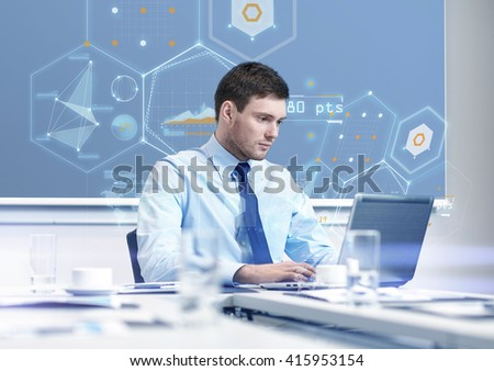 business, people and work concept - businessman with laptop computer and growth charts on virtual screen in office