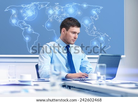 business, people and work concept - businessman with laptop computer and virtual world map sitting in office - stock photo