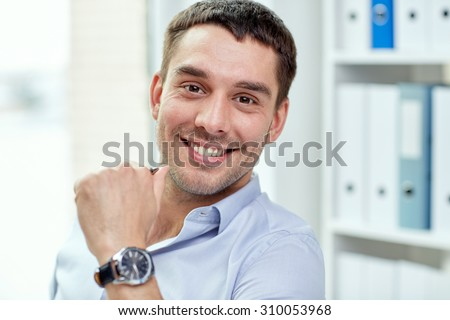 business, people and work concept - portrait of smiling businessman face in office - stock photo