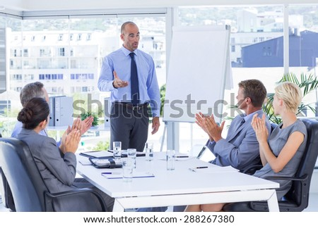 Business people applauding during meeting in the office - stock photo