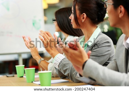 Business people applauding in a meeting. Business concept. - stock photo