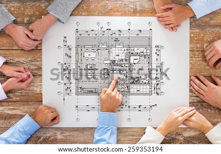business, people, architecture and team work concept - close up of architects team hands pointing finger to blueprint at office table - stock photo