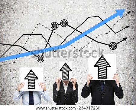 Business people are holding banners with drawn up arrows. Growth chart behind three persons on the wall. - stock photo