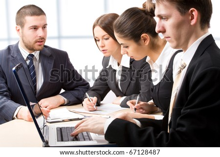 Business people at a meeting in a  modern office environment - stock photo