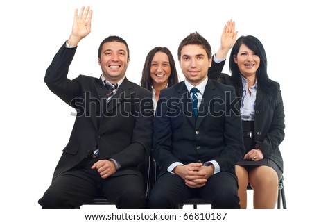 Business people at course or auction raise hands  and laughing - stock photo