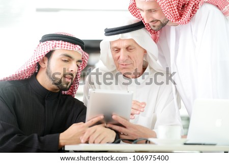 Business people at Middle east working on tablet PC - stock photo