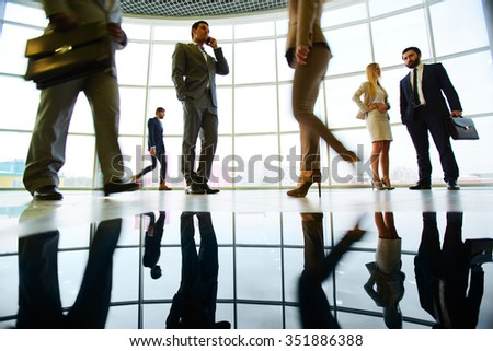 Business people at modern office during work day - stock photo
