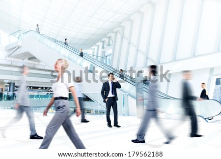 Business People at Rush Hour in Office Building - stock photo