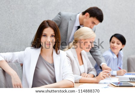 Business people at the meeting discuss current issues at the modern office building - stock photo