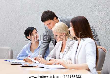 Business people at the meeting discuss current issues at the modern office building. Teamwork success - stock photo