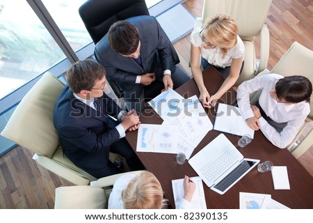 Business people at the negotiating table in the office - stock photo