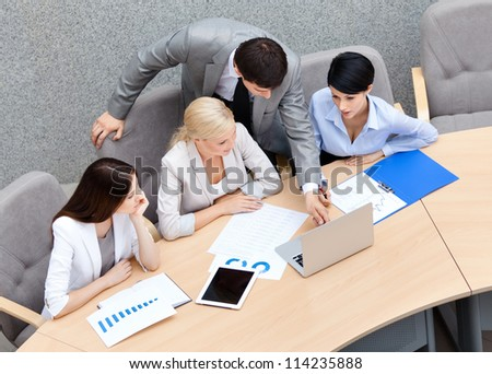 Business people at the presentation discuss current issues at the modern office building. Cooperation process - stock photo