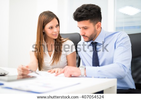 Business people at work in their office, Shallow depth of field, focus on the woman - stock photo
