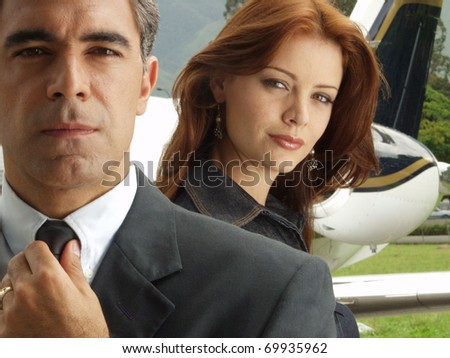 Business people before boarding a private jet. - stock photo